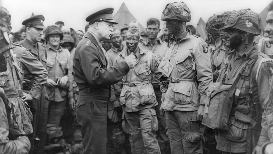 FILE: June 5, 1944: Allied Forces Supreme Commander Gen. Dwight Eisenhower with U.S. troops, Greenham Common Airfield, England.