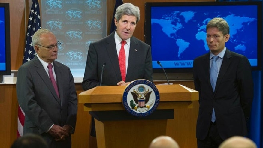 Secretary of State John Kerry, joined by Rabbi David Saperstein, nominated to become ambassador at large for international religious freedom at the State Department, left, and Tom Malinowski, Assistant Secretary of State for Democracy, Human Rights and Labor, right, speaks at the State Department in Washington, Monday, July 28, 2014.