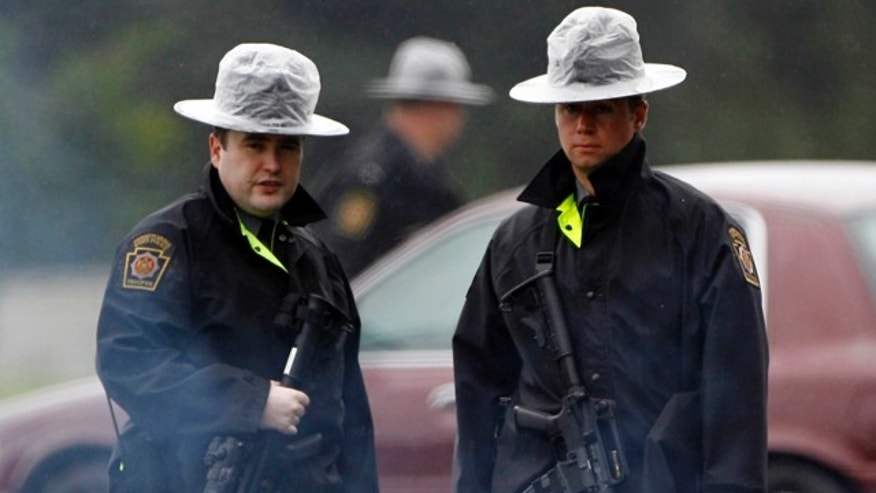 August 28, 2011: Pennsylvania State Police troopers man a roadblock in Furlong, Pa. (AP)