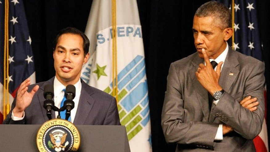 President Barack Obama listens as he is introduced by new Housing and Urban Development Secretary Julian Castro, Thursday, July 31, 2014, at the Housing and Urban Development Department in Washington. (AP Photo/Jacquelyn Martin)