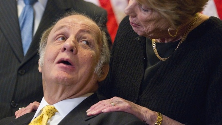 This March 30, 2011 file photo shows former White House press secretary James Brady looking at his wife Sarah Brady during a news conference on Capitol Hill.