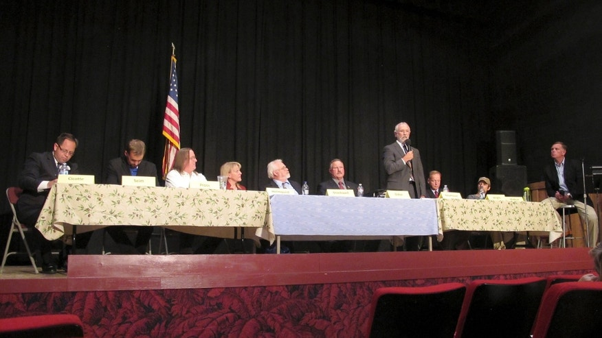 June 30, 2014: Dan Newhouse, a U.S. House candidate running in the 4th District of Washington, standing, speaks as other candidates listen, at a forum in Othello, Wash. A total of 13 candidates are running to replace U.S. Rep. Doc Hastings.