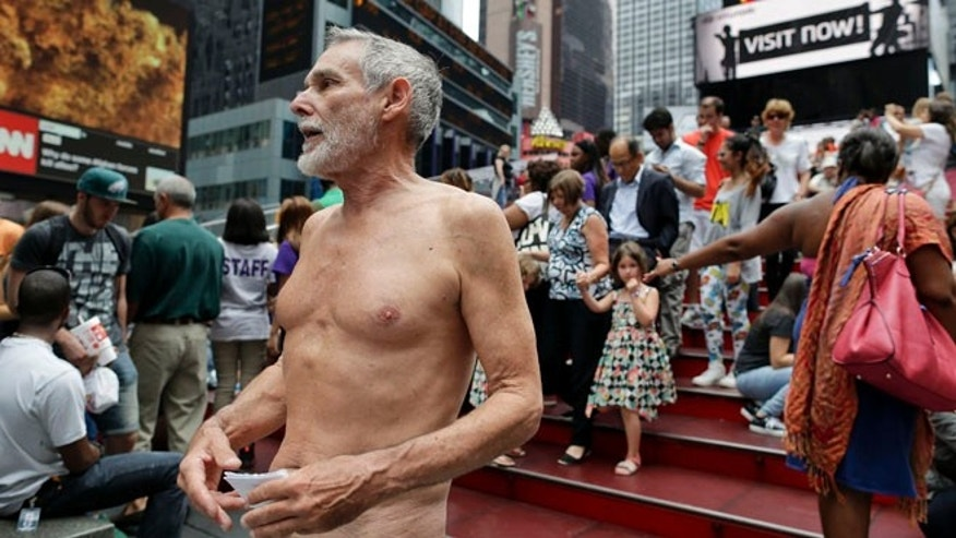 George Davis, a candidate for the San Francisco Board of Supervisors, makes a speech in the nude on Times Square, Wednesday, Aug. 6, 2014, in New York.