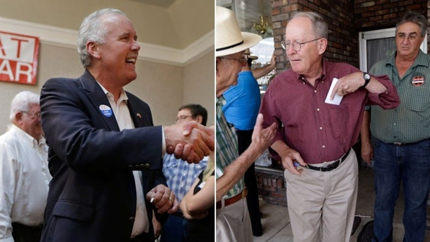 In this July 22, 2014 photo, Joe Carr greets supporters at a campaign stop in Nashville, Tenn and Sen. Lamar Alexander, campaigns in Lawrenceburg, Tenn., in this Aug. 5, 2014 photo.