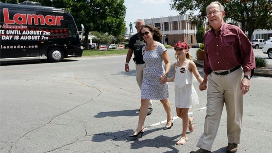 In this Aug. 5, 2014 photo, Sen. Lamar Alexander, R-Tenn., walks to a campaign stop with his daughter, Leslee Alexander, left, and granddaughter, Taylor Irwin, in Lawrenceburg, Tenn.