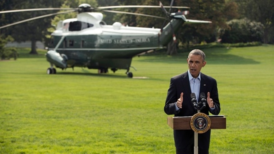 President Barack Obama speaks on the South Lawn of the White House in Washington, Saturday, Aug. 9, 2014, about ongoing situation in Iraq before his departure on Marine One for a vacation in Martha's Vineyard. Obama announced late Thursday that he had ordered military airstrikes in northern Iraq to hold off Islamic State forces advancing on the Kurdish capital of Irbil. Obama also ordered airdrops of food and water to member of a religious minority group who fled into the mountains to escape the militants. (AP Photo/Pablo Martinez Monsivais)