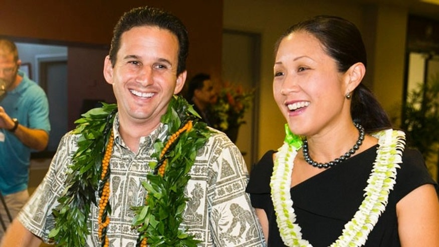 US Sen. Brian Schatz, left, and Linda Kwok Schatz attend the Democratic Unity Breakfast, Sunday, Aug. 10, 2014 in Honolulu.