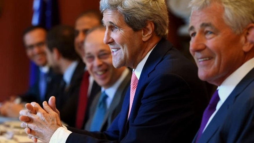 August 12, 2014: U.S. Secretary of State John Kerry, second from right, along with U.S. Secretary of Defense Chuck Hagel, right, addresses the start of the Australia-US Ministerial Consultations (AUSMIN) talks at Admiralty House in Sydney. (AP Photo/Dan Himbrechts, Pool)