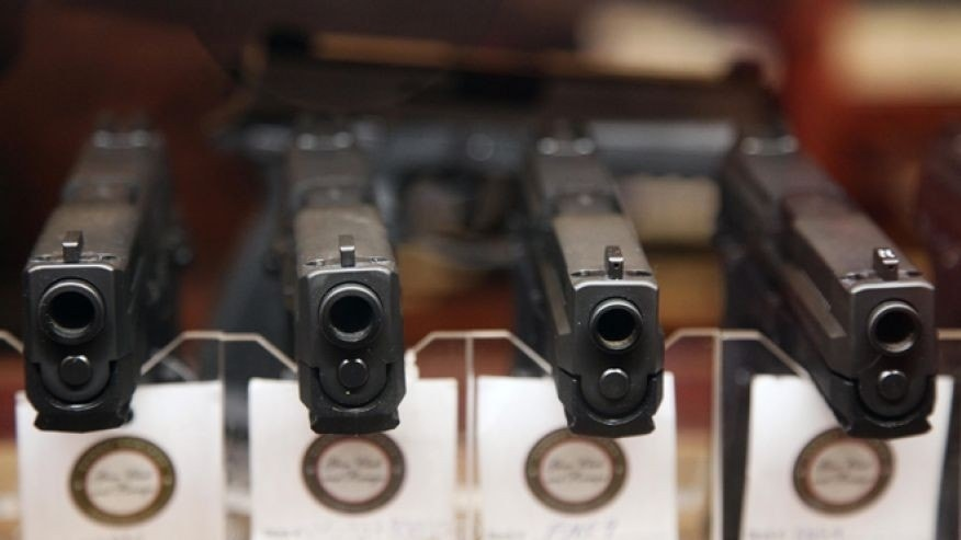Jan. 4, 2013: Handguns are displayed in the sales area of Sandy Springs Gun Club and Range, in Sandy Springs, Ga.