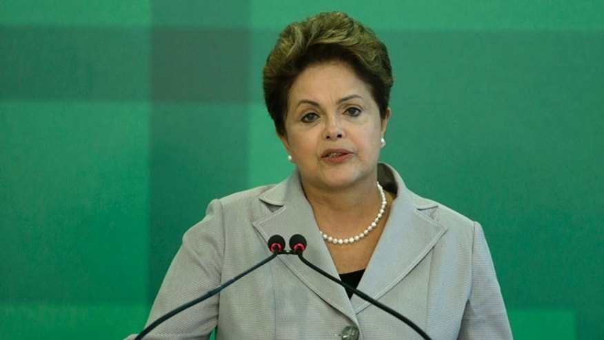Brazil's President Dilma Rousseff speaks on the death of presidential candidate Eduardo Campos, at the Planalto Presidential Palace in Brasilia, Brazil, Wednesday, Aug. 13, 2014. Campos died Wednesday when the small plane that was carrying him and several campaign officials plunged into a residential neighborhood in the port city of Santos, a City Hall official there said. (AP Photo/Eraldo Peres)