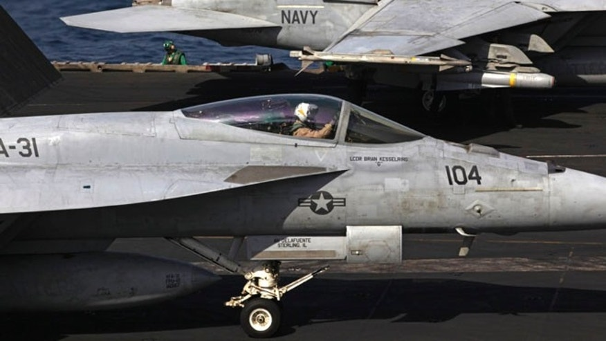 U.S. F/A-18 fighter jets prepare to take off for Iraq from the flight deck of the U.S. Navy aircraft carrier USS George H.W. Bush in the Persian Gulf, Monday, Aug. 11, 2014.
