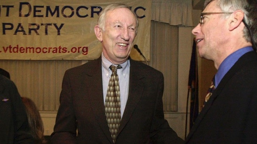 In this March 14, 2003, file photo, Sen. Jim Jeffords, I-Vt., center, laughs with Vermont Democratic Party Chairman Scudder Parker at the annual Democratic Party dinner in Montpelier, Vt.