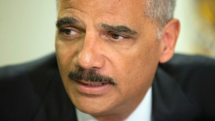 Aug. 20, 2014: Attorney General Eric Holder speaks during his meeting at the FBI building in St. Louis.