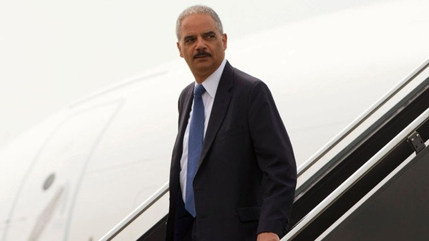 Attorney General Eric Holder arrives on US Military aircraft at Lambert-St. Louis International Airport in St. Louis, Wednesday, Aug. 20, 2014.