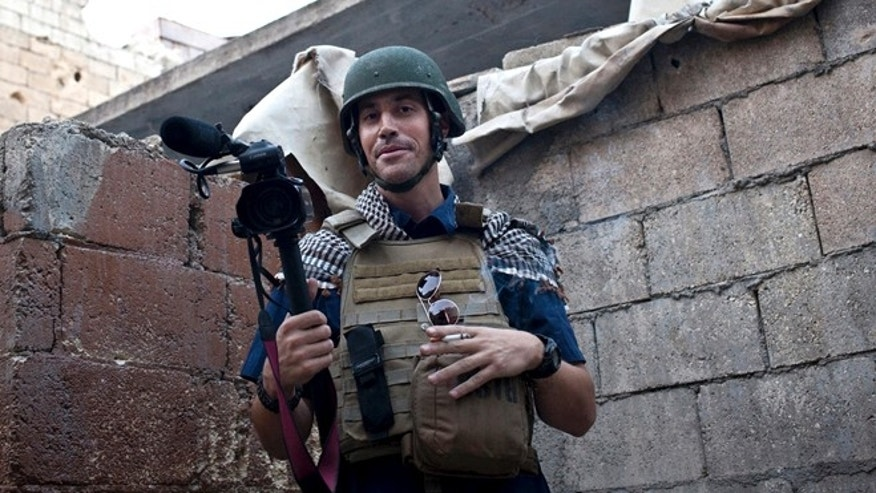 FILE - In this November 2012, file photo, posted on the website freejamesfoley.org, shows American journalist James Foley while covering the civil war in Aleppo, Syria. In a horrifying act of revenge for U.S. airstrikes in northern Iraq, militants with the Islamic State extremist group have beheaded Foley  and are threatening to kill another hostage, U.S. officials say. (AP Photo/freejamesfoley.org, Nicole Tung, File)