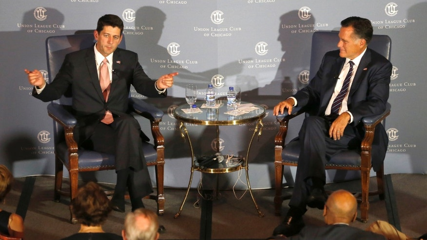 Aug. 21, 2014: Former Massachusetts Gov. Mitt Romney, right, listens to the response of his former vice-presidential running mate U.S. Rep. Paul Ryan, R-Wis., during an interview about Ryan's new book.