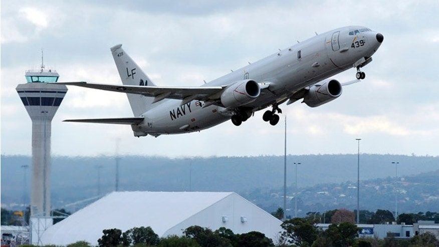 A U.S. Navy P-8 Poseidon aircraft takes off from Perth International Airport on April 16, 2014.