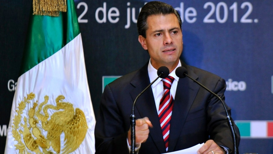 MEXICO CITY, MEXICO - JULY 2:  Presidential candidate Enrique Pena Nieto of the Institutional Revolutionary Party (PRI) speaks during a press conference on July 2, 2012 in Mexico City, Mexico. According to reports, a vote count by the independent Federal Electoral Institute (LIFE) has give Pena Nieto and the PRI the win in the presidential election, but it looks unlikely the will have a majority in either house of Congress.  (Photo by Daniel Aguilar/Getty Images)