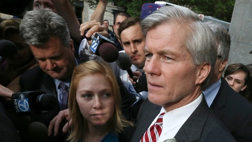 Aug. 21, 2014: Former Virginia governor Bob McDonnell puts his arm around his daughter Cailin Young as he leaves the federal courthouse in Richmond, Va.