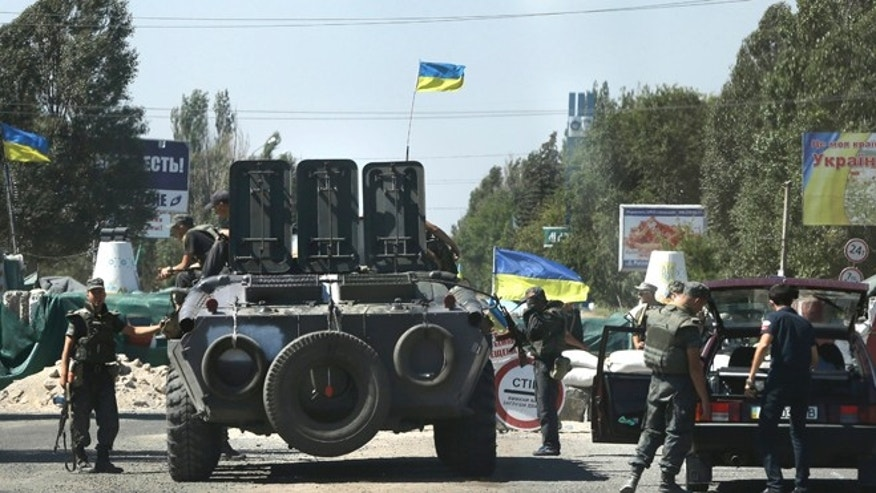 Aug. 27, 2014: Ukrainian soldiers at a checkpoint in the town of Mariupol, eastern Ukraine.
