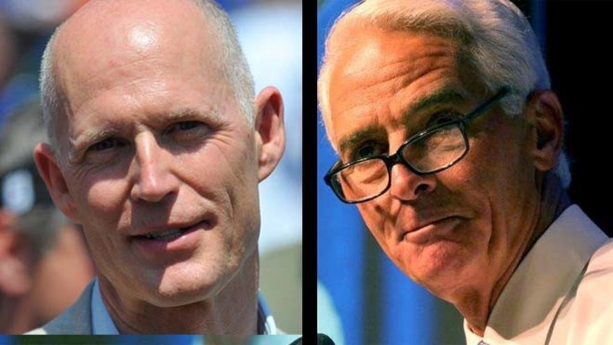 Florida Gov. Rick Scott, Republican, left; Democratic challenger Charlie Crist, right
