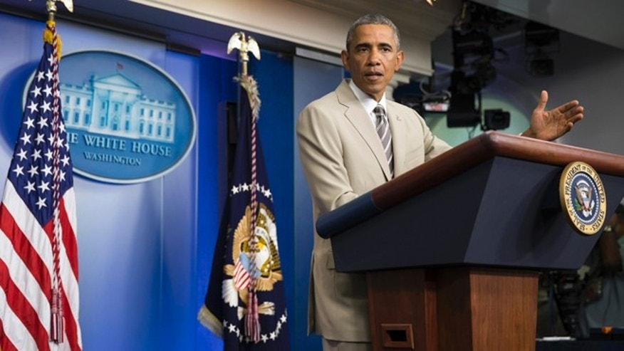 President Barack Obama in the James Brady Press Briefing Room of the White House in Washington, Thursday, Aug. 28, 2014.