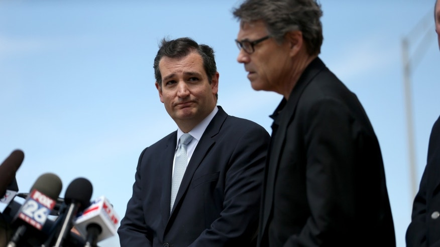 FORT HOOD, TX - APRIL 04:  Sen. Ted Cruz (R-TX) (L) and Texas Governor Rick Perry speak to the media during a press conference at the front gate of Fort Hood about Iraq war veteran, Ivan Lopez, who killed three and wounded 16 before taking his own life on April 4, 2014 in Fort Hood, Texas. The investigation continues into why Lopez did the shooting on the base.  (Photo by Joe Raedle/Getty Images)