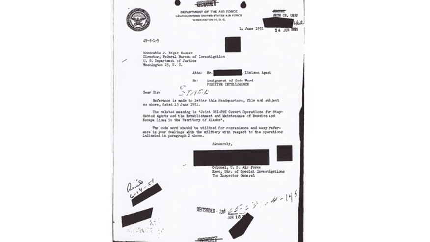 This Sept. 6, 1951 handout image obtained by The Associated Press shows the first of a two-part Air Force memo informing Federal Bureau of Investigation Director J Edgar Hoover of the assignment and project, code worded Washtub. (AP)
