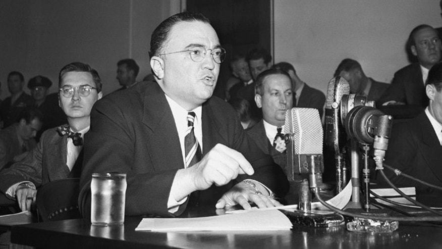"This March 26, 1947, file photo shows Federal Bureau of Investigation Director J. Edgar Hoover calling the communist party of the United States a ""Fifth Column"" whose ""goal is the overthrow of our government"" during testimony before the House Un-American Activities Committee in Washington. (AP)"