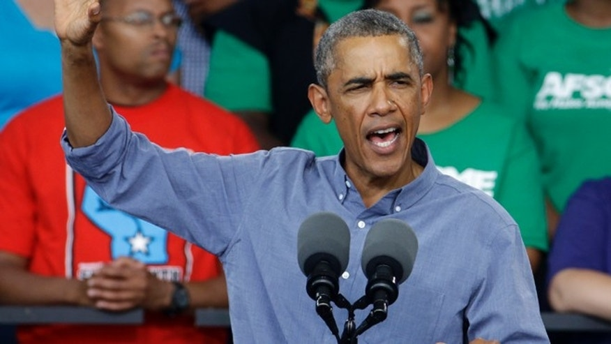 FILE: Sept. 1, 2014: President Obama speaks at Laborfest 2014, at Henry Maier Festival Park, in Milwaukee, Wis.