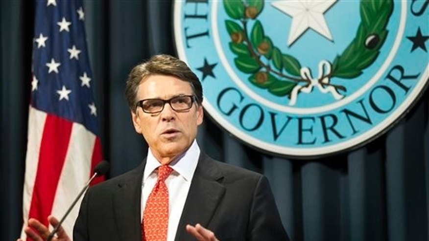 Gov. Rick Perry makes a statement in Austin, Texas on Saturday, Aug. 16, 2014 concerning the indictment on charges of coercion of a public servant and abuse of his official capacity. Perry is the first Texas governor since 1917 to be indicted. (AP Photo/Austin American-Statesman - statesman.com, Laura Skelding)