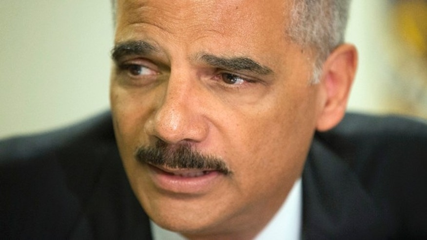 Attorney General Eric Holder during his meeting at the FBI building in St. Louis, Wednesday, Aug. 20, 2014. (AP Photo/Pablo Martinez Monsivais, Pool)