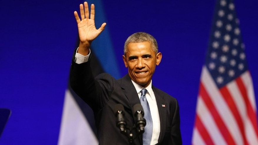 U.S. President Barack Obama waves after speaking at Nordea Concert Hall in Tallinn, Estonia, Wednesday, Sept. 3, 2014.