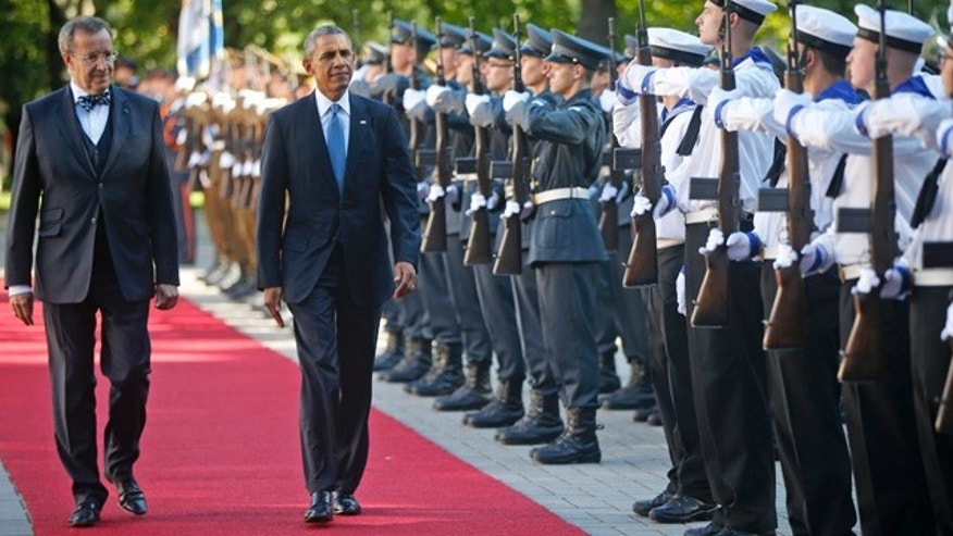 September 3, 2014: U.S. President Barack Obama and Estonian President Toomas Hendrik Ilves review the honor guard at Kadriorg Palace in Tallinn. (AP Photo/Charles Dharapak)