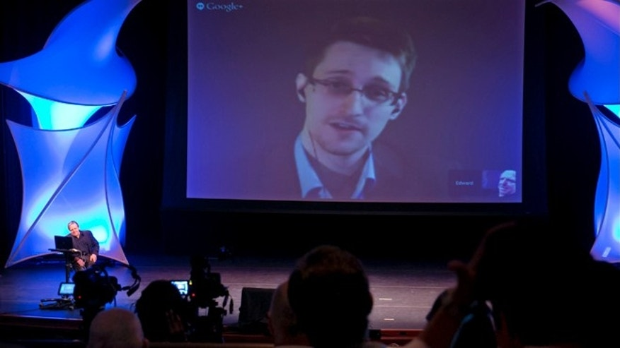 June 5, 2014: Former NSA contractor Edward Snowden participates in a conversation via video with John Perry Barlow, co-founder and vice chairman of the Electronic Frontier Foundation at the 2014 Personal Democracy Forum at New York University in New York.