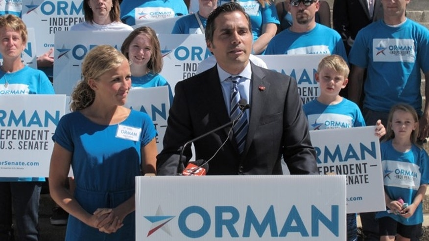 FILE: July 28, 2014: Greg Orman an independent candidate for Senate in Kansas, and wife Sybil campaigning in Topeka, Kansas.