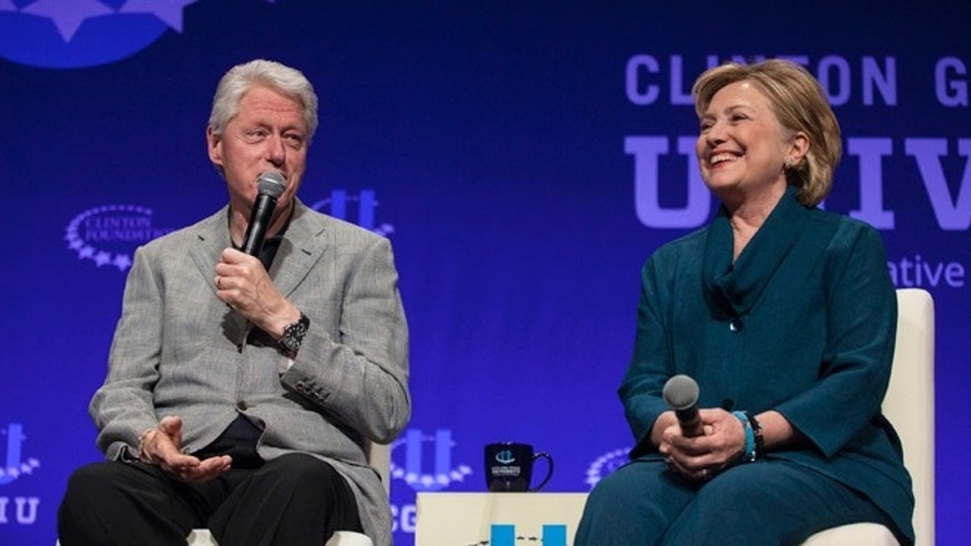 FILE: Former President Clinton and former Secretary of State Hillary Clinton at the 2014 Clinton Global Initiative at Arizona State University, Tempe, Ariz.