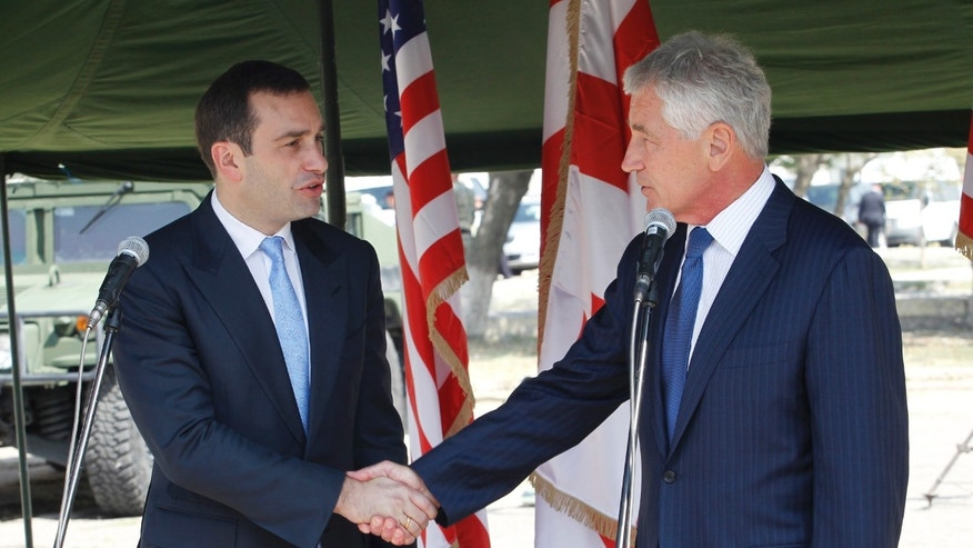 Sept. 7, 2014: Georgia's Defense Minister  Irakli Alasania, left, and U.S. Defense Secretary Chuck Hagel shake hands at the Krtsanisi military training base outside Tbilisi  Georgia.