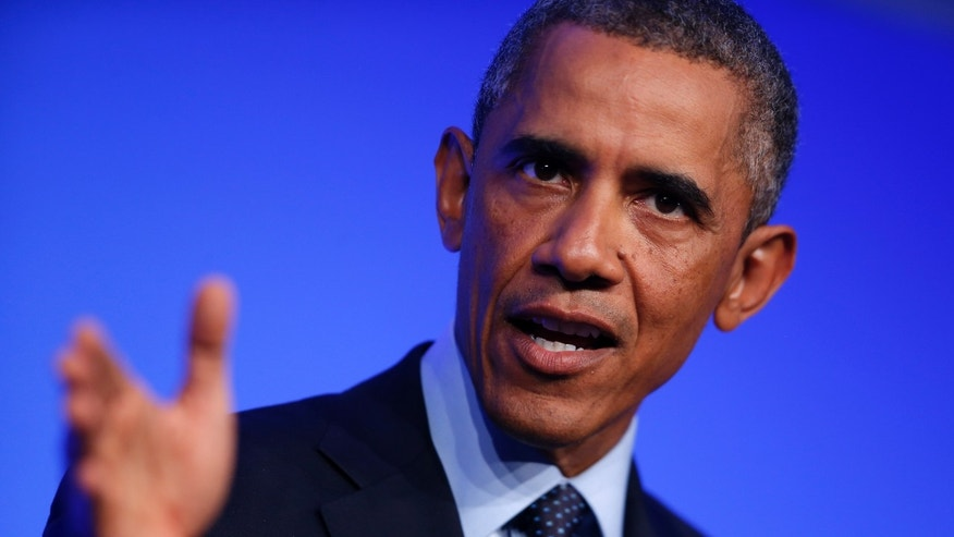 President Barack Obama speaks at a news conference at the NATO summit at Celtic Manor, Newport, Wales, Friday, Sept. 5, 2014. (AP Photo/Charles Dharapak)