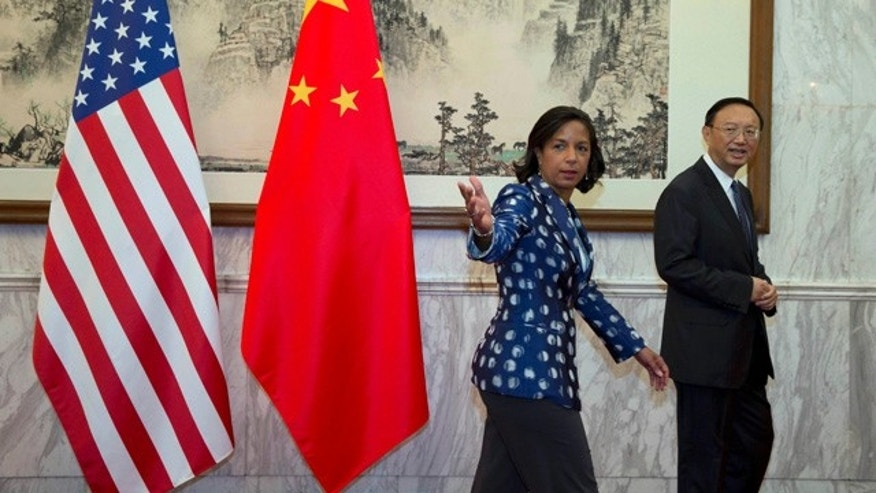 September 8, 2014: U.S. National Security Advisor Susan Rice, left, gestures as she walks with Chinese State Councilor Yang Jiechi, right, before a meeting at the Diaoyutai State Guesthouse in Beijing. (AP Photo/Ng Han Guan, Pool)