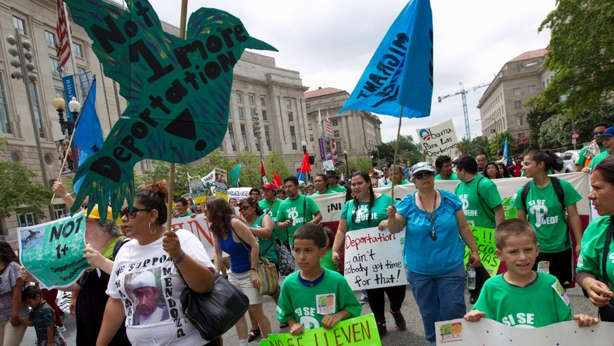 FILE - This Aug. 2, 2014 file photo shows demonstrators protesting at Freedom Plaza in Washington asking President Barack Obama to modify his deportations policies. For years, President Barack Obama berated Republicans for putting their own political interests ahead of good policy on immigration. Now that he is delaying his own immigration plan until after Election Day, he has opened himself to charges from Democrats and Republicans that he's just as guilty of playing politics. The president's about-face, has left him with few allies going forward on an issue he had hoped would become a core component of his legacy. (AP Photo/Jose Luis Magana, File)