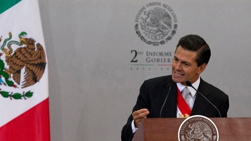 "FILE - In this Sept. 2, 2014 file photo, Mexico's President Enrique Pena Nieto gives his second state-of-the-nation address inside the National Palace in Mexico City. The Mexican president said in an interview with the newspaper El Universal published Friday, Sept 12, 2014, that Texas' decision to deploy National Guard troops along the border is ""unpleasant"" and ""reprehensible,"" and could affect bilateral relations. (AP Photo/Eduardo Verdugo, File)"