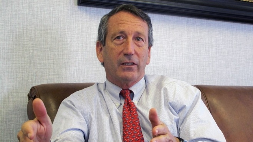 FILE - In this  Dec. 18, 2013 file photo, U.S. Rep. Mark Sanford, R-S.C., discusses his first months back in Congress during an Associated Press interview in his district office in Mount Pleasant, S.C. Sanford said on Friday, Sept. 12, 2014, that he and his fiancee are calling off their engagement due to the ongoing contention with his ex-wife Jenny Sanford, four years after their divorce. (AP Photo/Bruce Smith, File)