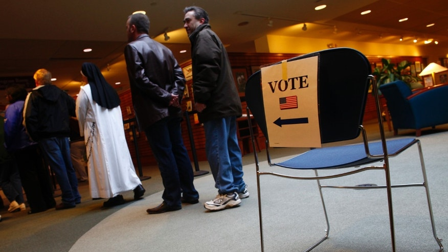 Nov. 6, 2012: People stand in line to vote during the U.S. presidential election in Janesville, Wisconsin.