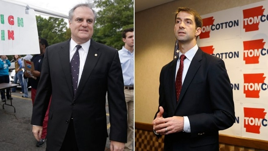 In this Saturday, Sept. 13, 2014 photo, U.S. Sen. Mark Pryor, D-Ark., arrives at a rally for campaign volunteers in Little Rock, Ark. and in this Thursday, Aug. 21, 2014 photo, U.S. Rep. Tom Cotton, R-Ark., speaks at a North Little Rock, Ark., news conference.