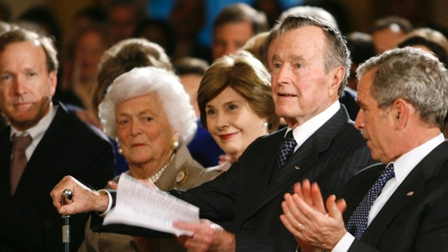 Jan. 7, 2009: Former U.S. President George H.W. Bush rises to speak at a reception in honor of the Points of Light Institute at the White House.  Also pictured are Neil Bush, former first lady Barbara Bush, first lady Laura Bush, President George W. Bush.