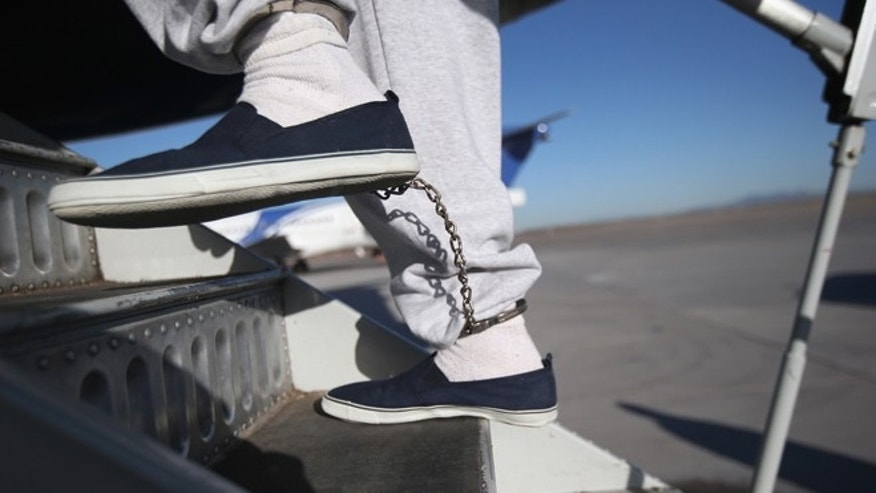 MESA, AZ - FEBRUARY 28:  A Honduran immigration detainee, his feet shackled as a security precaution, boards a deportation flight to San Pedro Sula, Honduras on February 28, 2013 in Mesa, Arizona. U.S. Immigration and Customs Enforcement (ICE), operates 4-5 flights per week from Mesa to Central America, deporting hundreds of undocumented immigrants detained in western states of the U.S. With the possibility of federal budget sequestration, ICE released 303 immigration detainees in the last week from detention centers throughout Arizona. More than 2,000 immigration detainees remain in ICE custody in the state. Most detainees typically remain in custody for several weeks before they are deported to their home country, while others remain for longer periods while their immigration cases work through the courts.  (Photo by John Moore/Getty Images)