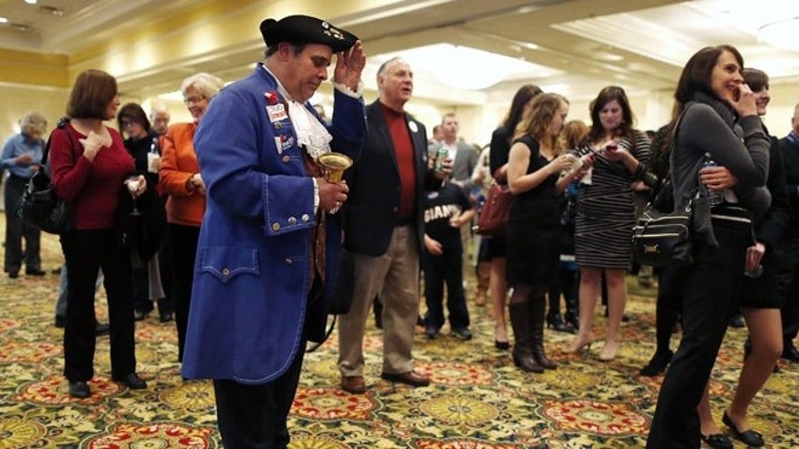 FILE: Nov. 5, 2013: A Tea Party member at a GOP event in Richmond, Va.