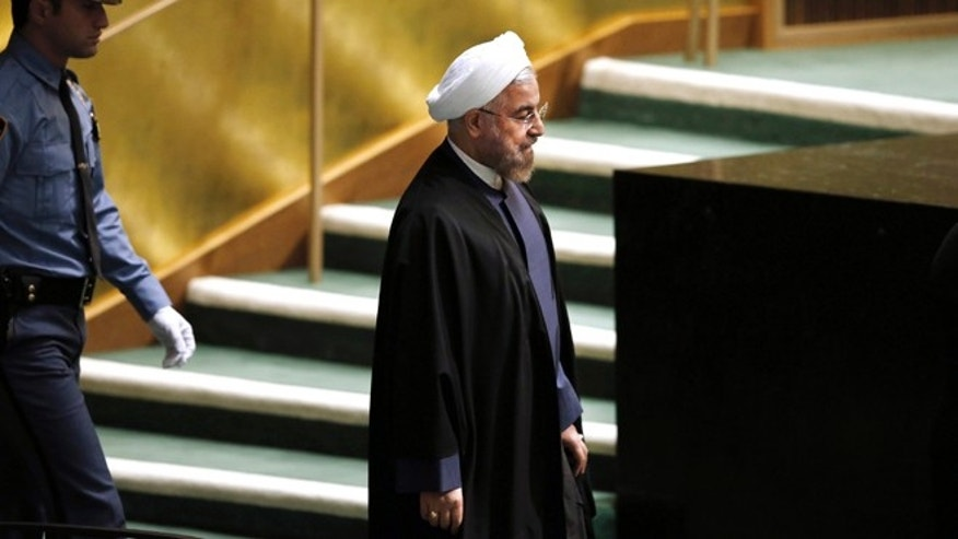 In this Thursday, Sept. 25, 2014 photo, President Hassan Rouhani of Iran walks in before addressing the 69th session of the United Nations General Assembly at U.N. headquarters.