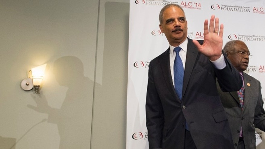 In this Friday, Sept. 26 photo, outgoing Attorney General Eric Holder waves at the Voting Rights Brain Trust event, during the 2014 Congressional Black Caucus Annual Legislative Conference in Washington.